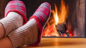 Feet Next To Fireplace
